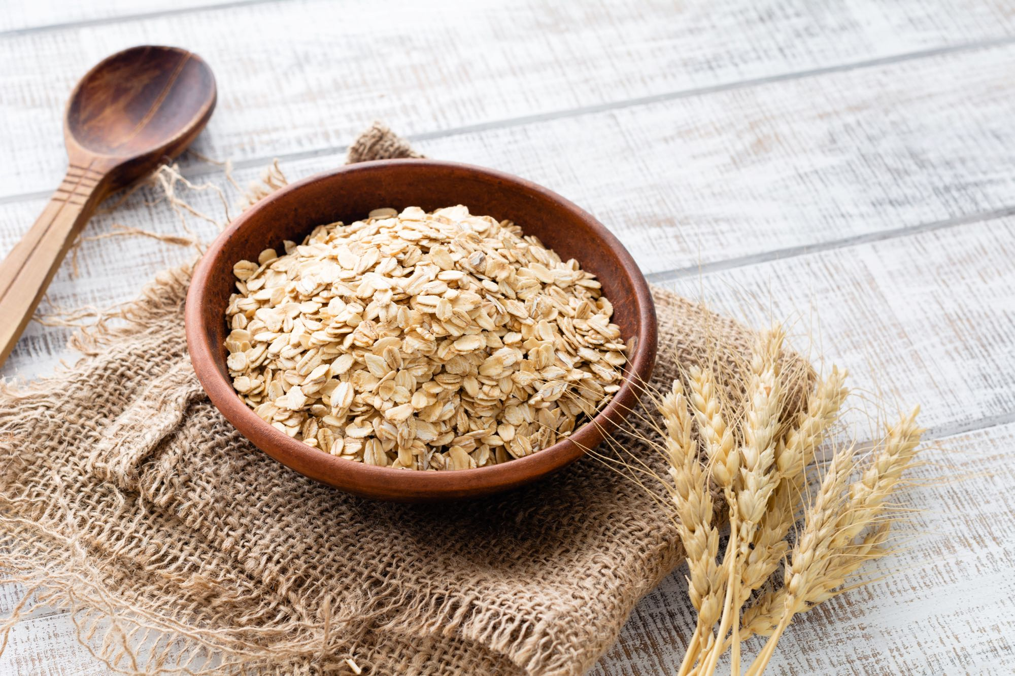 Bowl of oats on a wooden table