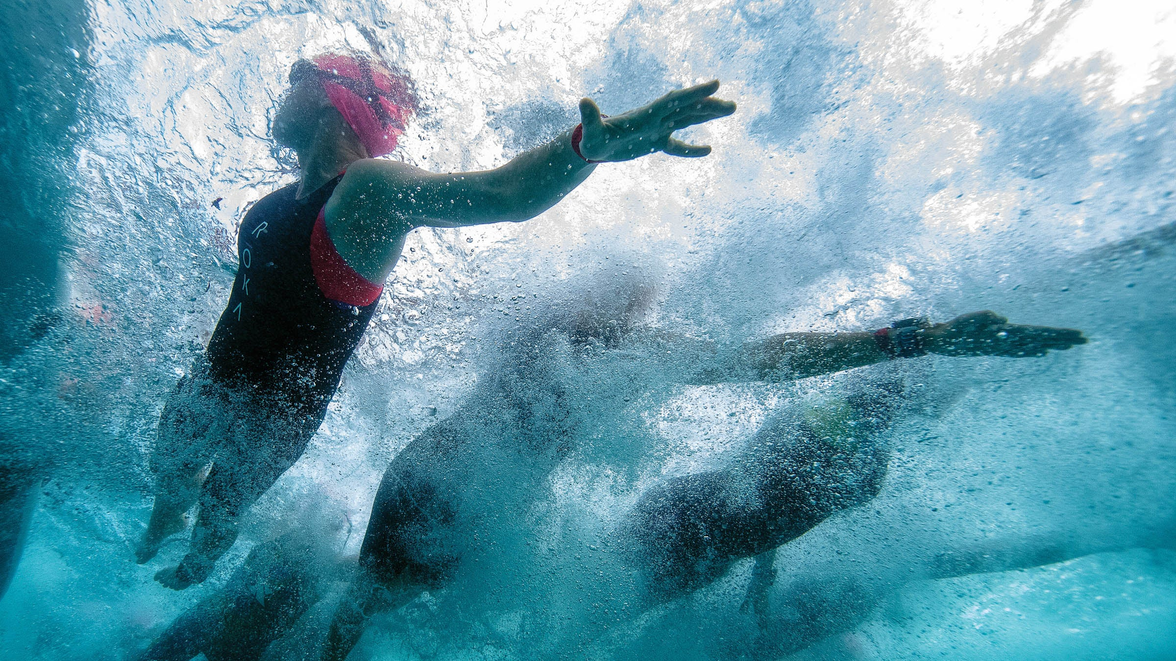 Swimmers drafting in a pack
