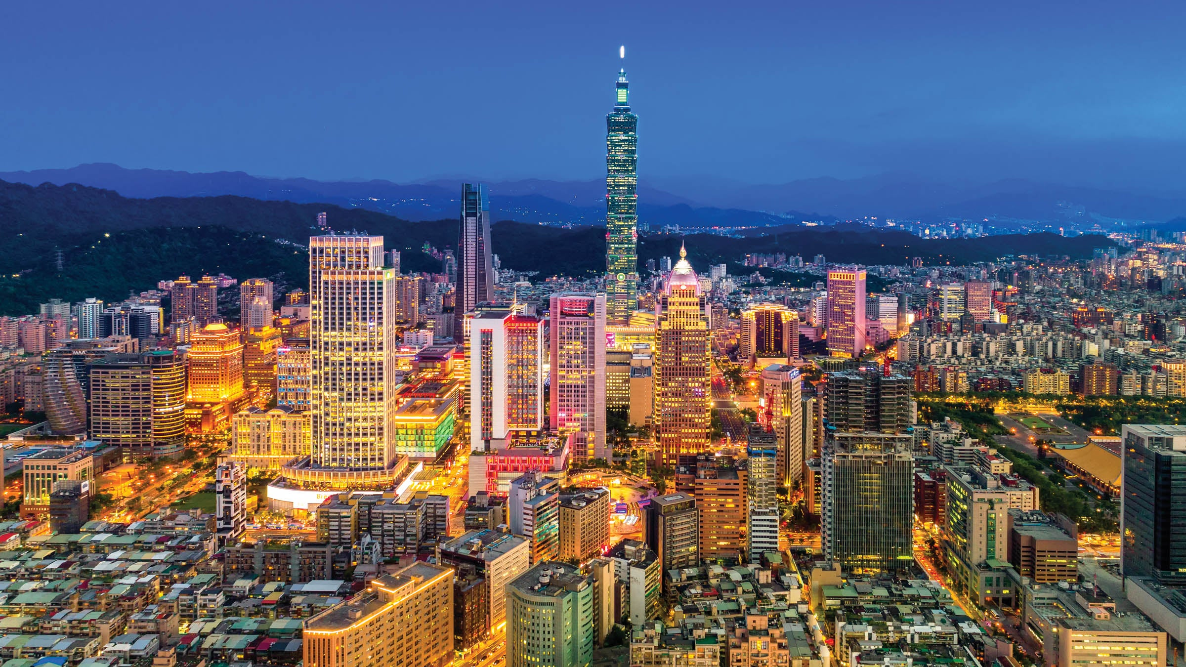 Capital city of Taiwan with view of prominent Taipei 101 Tower and busy street in Xinyi Financial District