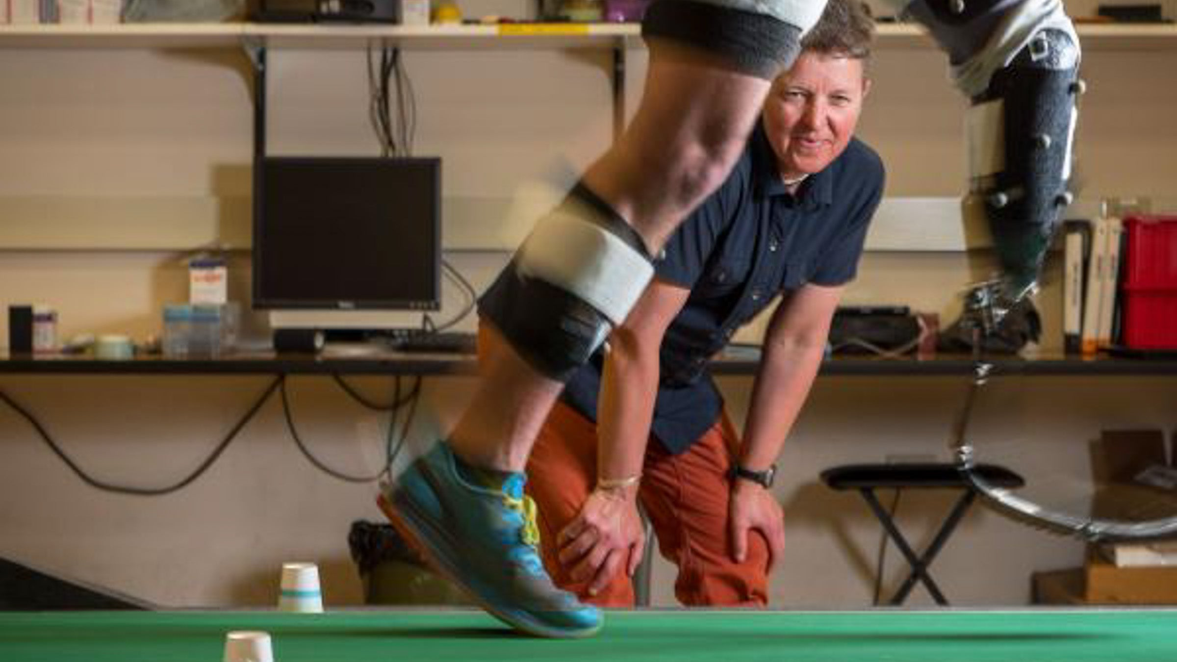 Dr. Alena Grabowski watches a runner with a blade prosthetic
